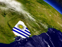 Uruguay with embedded flag on Earth Stock Photo