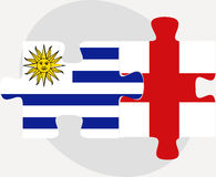 Uruguay and England Flags in puzzle Stock Photography