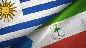 Uruguay and Equatorial Guinea two flags textile cloth, fabric texture. Uruguay and Equatorial Guinea two folded flags together stock illustration