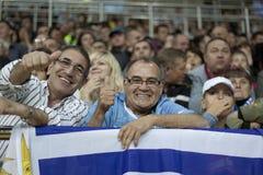 Uruguay fans. KHARKIV, UKRAINE - SEPTEMBER 2, 2011: Uruguay fans rejoice scored a goal in football match between national teams of Ukraine and Uruguay. The match Royalty Free Stock Images
