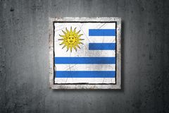 Uruguay flag in concrete wall Royalty Free Stock Images