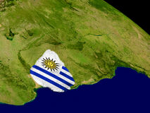 Uruguay with flag on Earth Royalty Free Stock Images