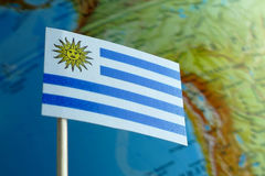 Uruguay flag with a globe map as a background Stock Photography