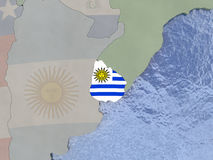Uruguay with flag on globe Royalty Free Stock Images