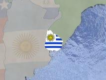 Uruguay with flag on globe Royalty Free Stock Image
