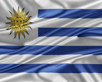 Uruguay flag with a glossy silk texture. Stock Photo
