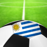 Uruguay Flag Pattern of a soccer ball in green grass. Stock Image