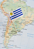 Uruguay flag pin on map. Paper flag pin of Uruguay, officially the Oriental Republic of Uruguay, on a map royalty free stock photo