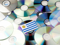 Uruguay flag on top of CD and DVD pile isolated on white. Uruguay flag on top of CD and DVD pile isolated Royalty Free Stock Photo