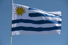 Uruguay flag of uruguayan nation waving in wind Stock Photography