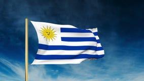 Uruguay-Flaggenschieberart Wellenartig bewegen in den Gewinn mit stock video
