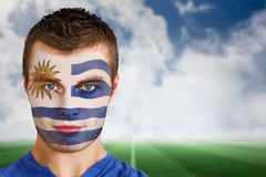 Uruguay football fan in face paint Royalty Free Stock Photos