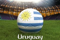 Uruguay football team ball on big stadium background. Uruguay Team competition concept. Uruguay flag on ball team tournament in Ru. Ssia. Sport competition on Royalty Free Stock Photography