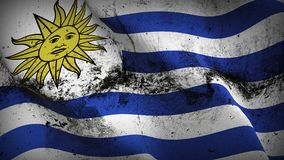 Uruguay grunge dirty flag waving on wind. Uruguayan background fullscreen grease flag blowing on wind. Realistic filth fabric texture on windy day Stock Images