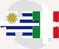 Uruguay and Italy Flags in puzzle Stock Photography