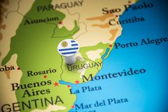 Uruguay marked with a flag on the map.  stock photography