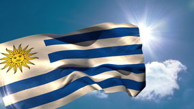 Uruguay national flag blowing in the breeze. On blue sky background with sun and clouds stock video footage