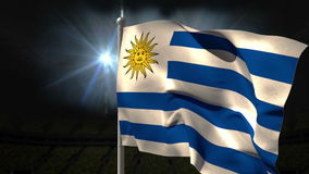 Uruguay national flag waving on flagpole. On black background with flashing lights stock video footage