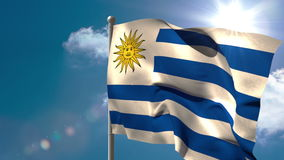 Uruguay national flag waving on flagpole. On blue sky background stock video footage