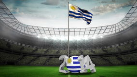 Uruguay national flag waving on flagpole. In football stadium with flashes and message 2014 stock video footage