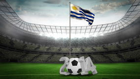 Uruguay national flag waving on flagpole with 2014 message. On football stadium with flashes stock footage
