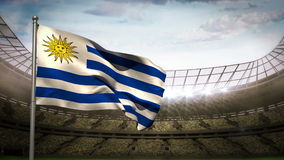Uruguay national flag waving on stadium arena. Uruguay national flag waving on flagpole on stadium arena background with spotlights stock video