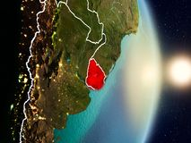 Uruguay during sunrise. Highlighted in red on planet Earth with visible country borders. 3D illustration. Elements of this image furnished by NASA Stock Photos