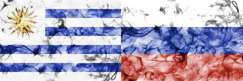 Uruguay vs Russia smoke flag. Isolated on a white background Royalty Free Stock Image