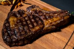 Uruguayan Beef steak in a rustic restaurant in Uruguay. Served with baked potatoes or chips Stock Photo