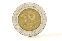 Uruguayan coin 2. $ 10 uruguayan coin over white background Royalty Free Stock Photography