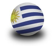 Uruguayan Football. Football (soccer ball) covered with the Uruguayan flag with shadow on a white background.  Clipping path included Stock Image