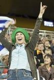 Uruguayan football female fan. KHARKIV, UKRAINE - SEPTEMBER 2, 2011: Unidentified Uruguayan football female fan rejoice scored a goal in football match between Royalty Free Stock Image