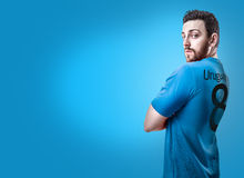 Uruguayan soccer player on blue background Stock Photos