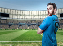 Uruguayan soccer player in the stadium.  Royalty Free Stock Image