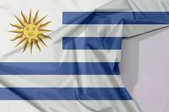 Urugwaj tkaniny flaga zagniecenie z biel przestrzenią i krepa obraz royalty free