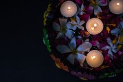 Uruli Decorated with light and flowers and tea light stock photo