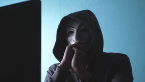 URYUPINSK. RUSSIA - FEBRUARY 6, 2019: masked hood hacker hacking the network - hacker and mask unknown hacker criminal stock video