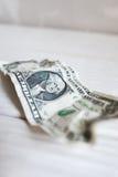Usé chiffonné un billet d'un dollar, trouble, plan rapproché Images libres de droits