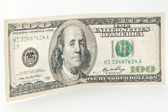 US 100 dollar bill on side. Closeup of standing 100 dollar bill with selective focus royalty free stock photos