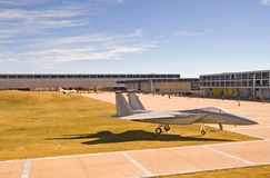 US Air Force Academy. A static display of an Air Force F-15 fighter jet and a vintage F-4 in the background on the parade grounds of the US Air Force Academy Royalty Free Stock Photos