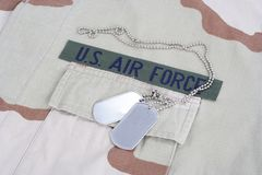 US AIR FORCE branch tape with dog tags on desert camouflage uniform Royalty Free Stock Images