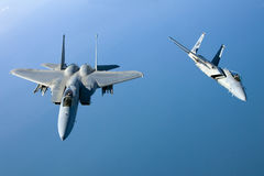 US Air Force F-15 Eagles fly over the Gulf Coast of Florida, USA. The Eagles are the Air Force`s main air superiority Royalty Free Stock Photo