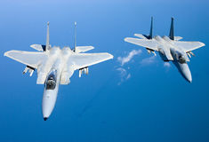 US Air Force F-15 Eagles fly over the Gulf Coast of Florida, USA. The Eagles are the Air Force`s main air superiority Stock Photo