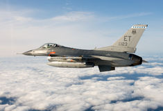 US Air Force F-16 Vipers flies over the Gulf coast of Florida, USA over Italy. The aircraft was testing a new laser Royalty Free Stock Photography