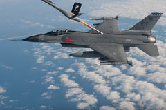 US Air Force F-16 Vipers flies over the Gulf coast of Florida, USA over Italy. The aircraft was testing a new laser Stock Image