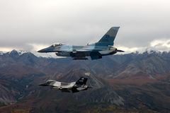US Air Force F-16 Vipers fly over Alaksa. Royalty Free Stock Photography