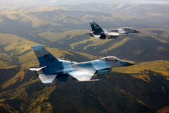 US Air Force F-16 Vipers fly over Alaksa. Stock Photography