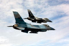 US Air Force F-16 Vipers fly over Alaksa. Royalty Free Stock Images