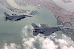 US Air Force F-16 Vipers fly over Italy. Stock Photography