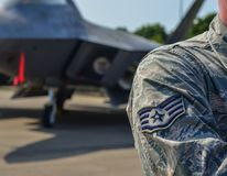 US Air Force soldier with aircrafts. US Air Force Sign on the uniform of a soldier, with aircraft background Stock Photography